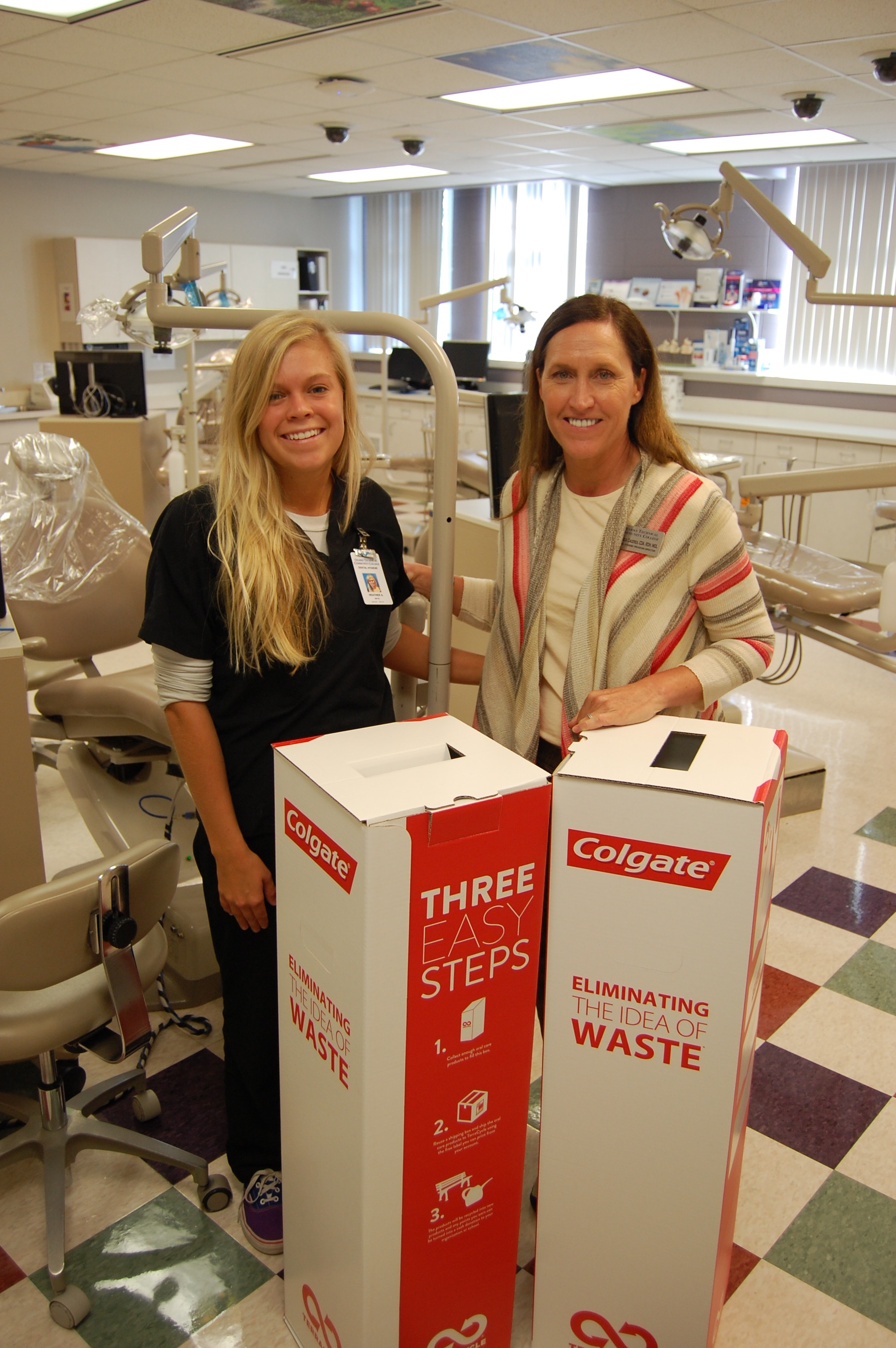 Heather Adkins (left) and Rebecca Caceres with recycling box.