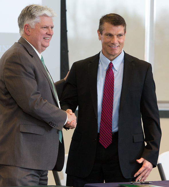 MSSU President  Dr. Alan Marble (left) and Dr. Steven Bishop, OTC provost and vice chancellor for academic affairs, shake hands after articulation agreement is signed.