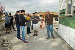 Justin Frese's Green Building Practices class takes turns viewing thermal bridging through an infrared camera.