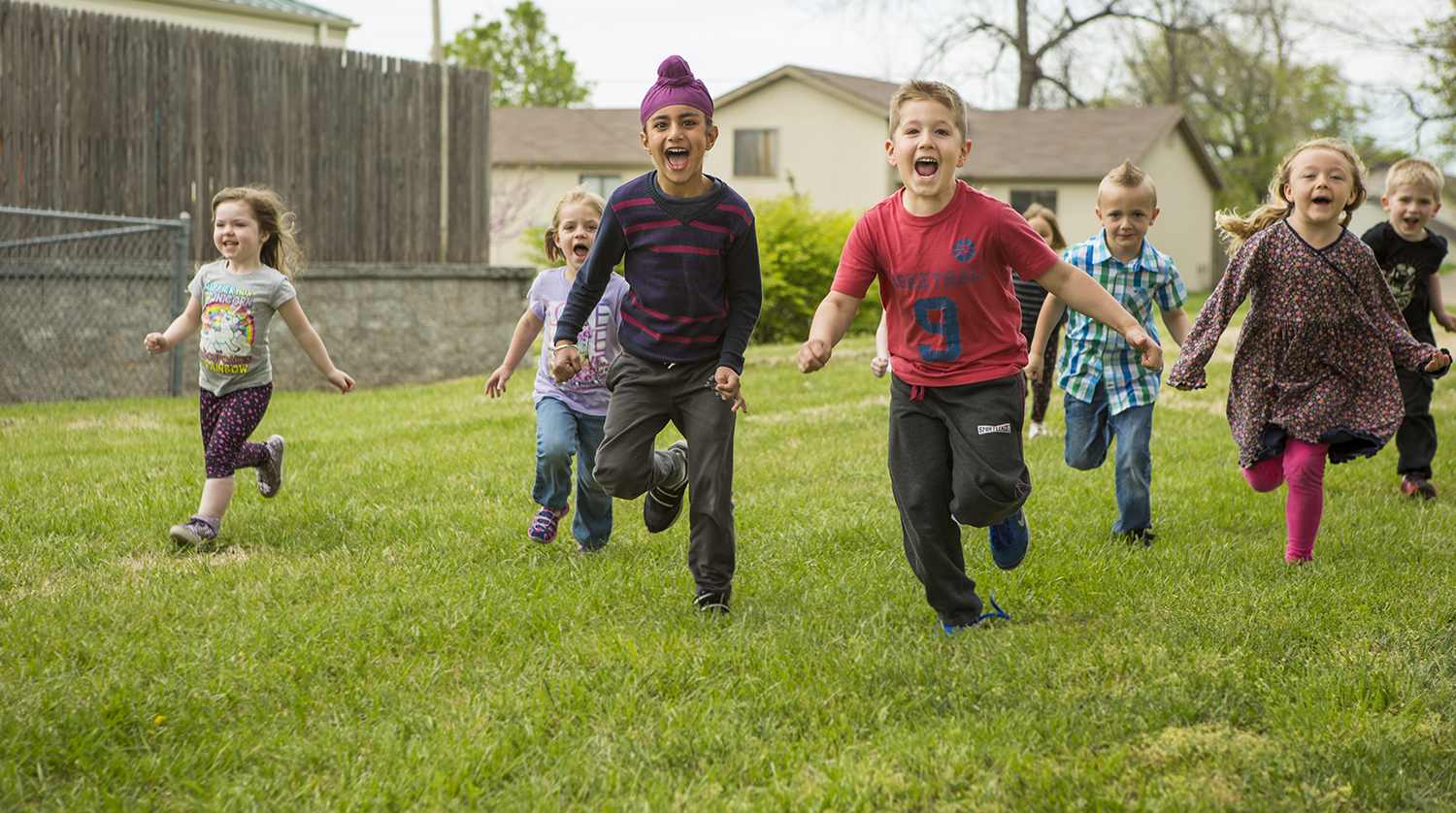 ECEC, Give Ozarks, Kids in the Grass