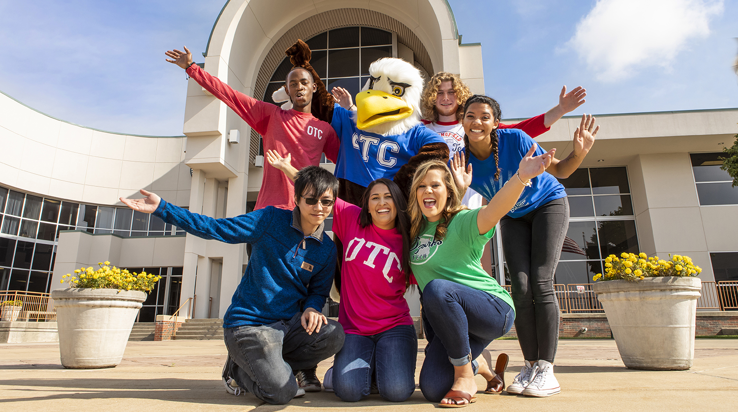 Ozzy the Eagle poses with OTC students on the Springfield campus plaza