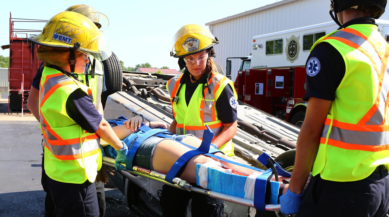 OTC paramedics participating in a crash simulation