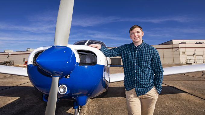 Taylor Fast, Aviation Student, Poses With OTC Plane